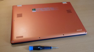 The Yoga 2 upside down with the TORX T5 scredriver ready for action