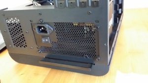 Lower part of the back panel with the PSU screwed into place.