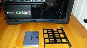The SSD with cradle below its slot in the drive rack.