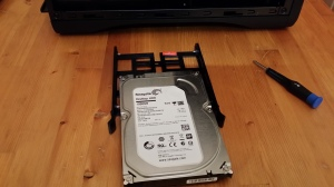 The HDD halfway into its cradle.
